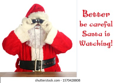 Santa Claus Christmas. Santa Claus looks through his Binoculars to see who has been Naughty or Nice. Isolated on white. Room for text. Santa is watching all year long. Ho Ho Ho.