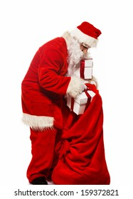 Santa Claus with christmas sack and gift boxes isolated on white background