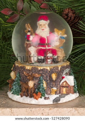 Santa Claus Christmas Snow Globe Decorations In A Traditional Home Living Room