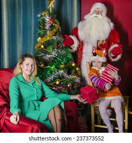 Santa Claus with Christmas wishes of people in the room