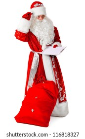 santa claus is creating wish list, isolated on white