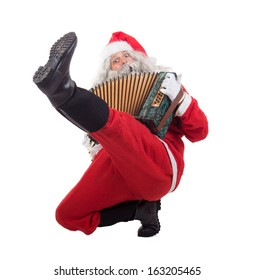 Santa Claus dancing traditional dance cossack isolated on white background. Christmas Concert Santa Claus. Funny Santa musician plays the accordion.