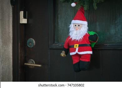 Santa Claus decoration hanging at a door