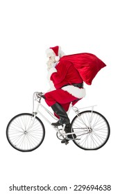 Santa claus delivering gifts with bicycle on white background