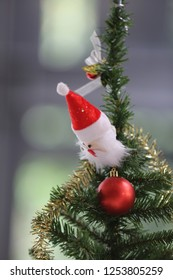 santa claus doll on christmas tree vertical