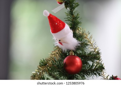 santa claus doll on christmas tree horizontal image