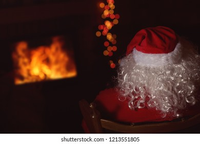 Santa Claus, dressed in costume resting at home