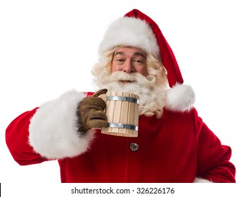 Santa Claus drinking beer from wooden cup. Portrait Isolated on White Background