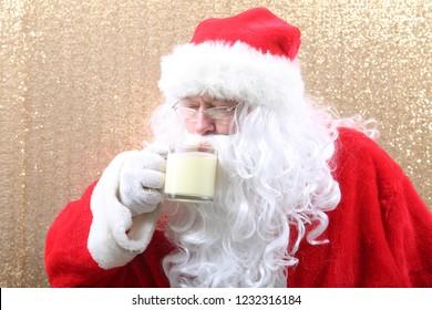 Santa Claus. Santa Claus drinks Eggnog for Christmas. Eggnog Drink. Holiday Traditional beverage. Food and Beverage,
