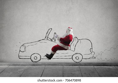 Santa Claus driving a car