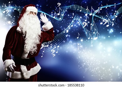 Santa Claus enjoying the sound of music