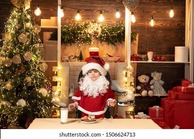 Santa Claus enjoys cookies and milk left out for him on Christmas eve. Milk and gingerbread cookie for Santa against Christmas light background. Milk and cookies for Santa Claus