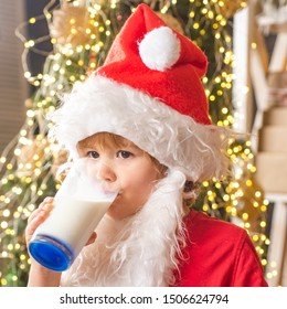 Santa Claus enjoys cookies and milk left out for him on Christmas eve. Merry Christmas. Santa picking cookie and glass of milk at home. Santa picking cookie