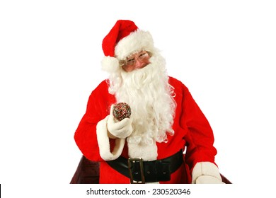 Santa Claus enjoys fresh baked piping hot donuts left for him as a thank you gift for all the nice presents he brings to good little boys and girls around the world. Santa loves donuts and stuff