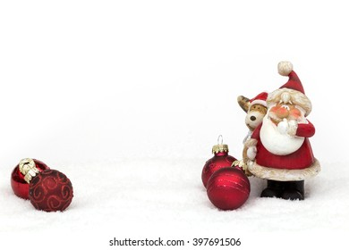 santa claus figure with little elk in the snow with christmas balls