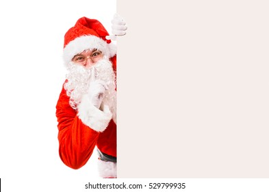 Santa Claus with finger on lips asking for silence, isolated on white background
