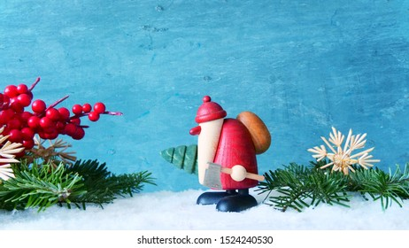 Santa Claus with fir-tree and ax in the snow