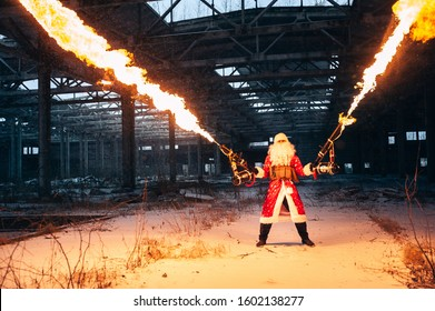 Santa Claus with flamethrowers in an abandoned warehouse