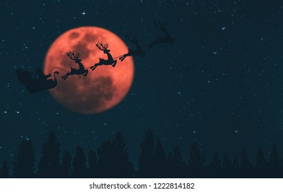 Santa Claus flying in his sleigh against moon sky / Concept merry christmas and happy new year 2019