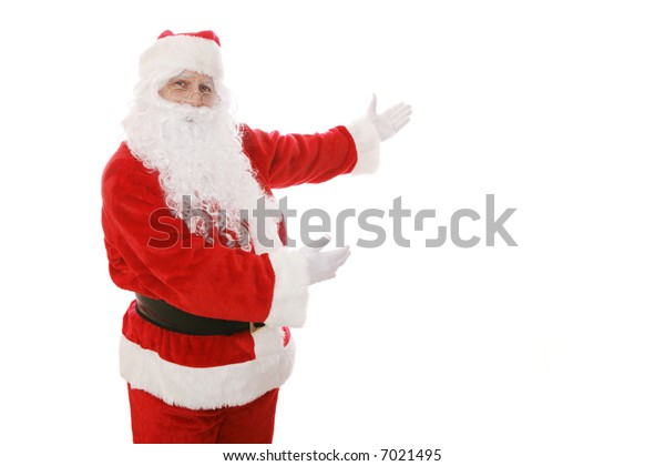 Santa Claus gesturing toward an area of copy space.  Isolated design element.