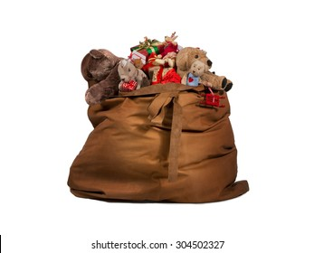 Santa Claus gift bag full of toys and gifts isolated over white background