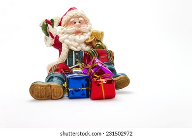 Santa Claus with gift boxes - toy - isolated on white background