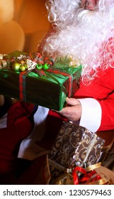 Santa Claus with gift on Christmas Eve