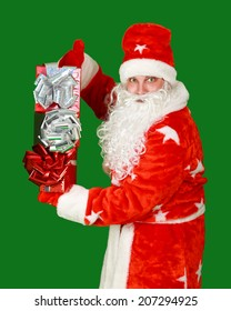 Santa Claus with gifts for Christmas shot in a studio on a contrasting green background