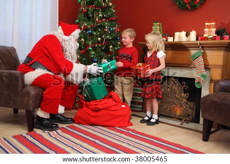 santa claus gives christmas gifts to children