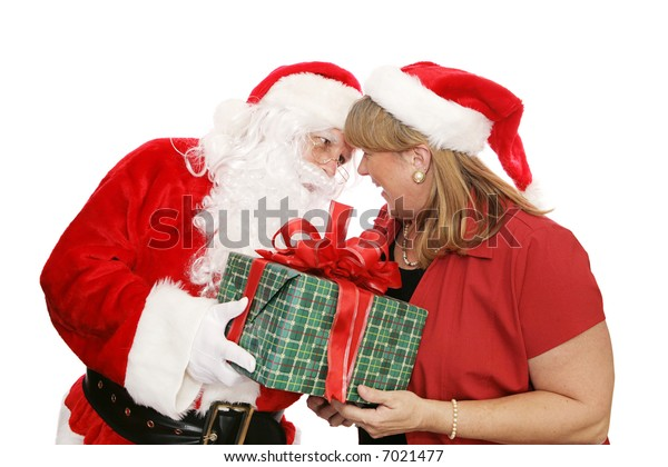 Santa Claus giving a gift to Mrs. Santa.  Isolated on white.