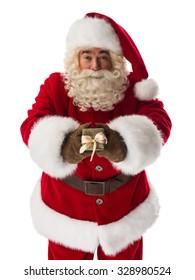 Santa Claus giving small gift box to camera Closeup Portrait
