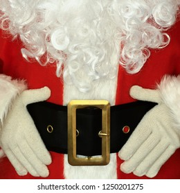 Santa Claus with gloves holding his belt. Holiday, Christmas, xmas concept.