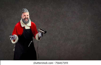 Santa Claus hairdresser barber with scissors and a hair dryer in his hands on the background of copyspace.