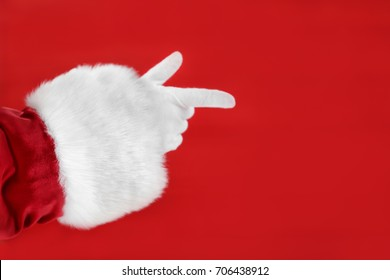 Santa Claus hand against red background