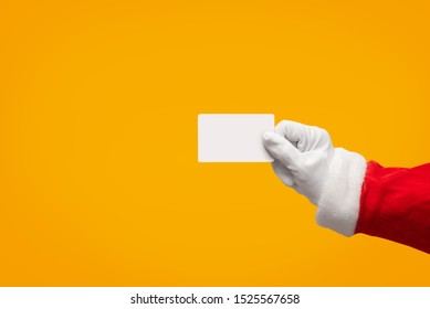 Santa Claus hand holding blank plastic credit card over isolated background with Clipping Path. Shopping, Sales, Giving Gift for Black Friday, Christmas and New Year 2019 concepts.