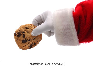 Santa Claus Hand holding a chocolate chip cookie over a white background. Horizontal format showing Santa's hand a arm only.
