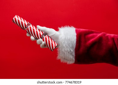 Santa Claus hand holding a Christmas cracker