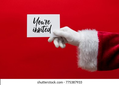 Santa Claus hand holding a Christmas sign