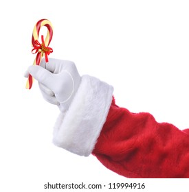 Santa Claus hand holding an Old Fashioned Candy Cane with a ribbon and bells.
