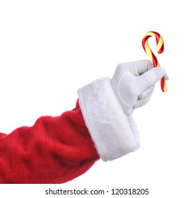 Santa Claus hand holding an Old Fashioned Candy Cane. Isolated on white, hand and arm only.