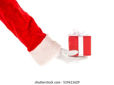 Santa Claus hand holding out gift box isolated on white