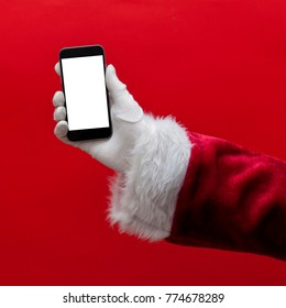 Santa Claus hand holding a smartphone with a blank screen