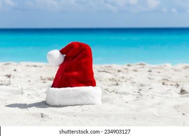 Santa Claus hat at caribbean sandy beach, Cancun. Holiday concept