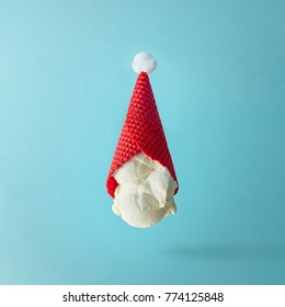 Santa Claus hat made of upside down vanilla ice cream. Christmas holiday minimal concept.