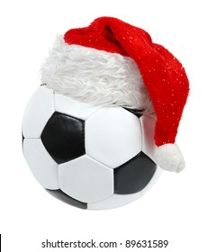 Santa Claus hat on the soccer ball on the white background. (isolated)