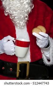 santa claus having coffee with cookies