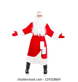 Santa Claus hold wide open palm welcome gesture full length portrait with raised gloves hands arms, isolated on white background, merry christmas time and happy new year