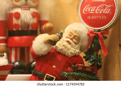 Santa Claus is holding a bottle of coke. At the Bangkhen Museum, Bangkok, Thailand, September 8, 2018.