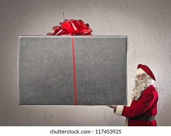 Santa Claus holding a giant present