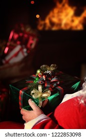 santa claus holding a gift on christmas eve
